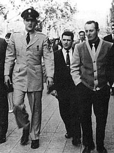 Elvis, Charlie Hodge & Rex strolling through Paris (you can tell that Elvis is 6 ft tall in this photo).