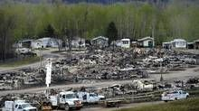 Electrical crews are seen working among burned-out buildings in the Beacon Hill neighbourhood of Fort McMurray, Alta., during a media tour of the fire-damaged Alberta city on Monday, May (THE CANADIAN PRESS/Ryan Remiorz) Fort Mcmurray, Fourth Wall, Beacon Hill, Firefighter, Touring, The Neighbourhood, Lost, Hard Work, World