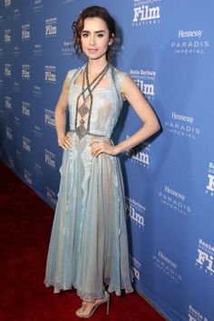 Lily Collins wore an intricate, ice blue lace dress with gunmetal embellished detailing.
