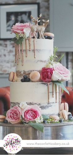 Modern semi-naked wedding cake with macarons, rose gold drips and fresh flowers. Stag and deer cake topper. Cake & Image: The Confetti Cakery. Venue: The West Mill, Derby.