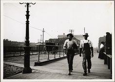 Two men on Charles St. Bridge, Baltimore