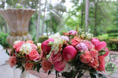 Breathtaking peonies and rose bridal bouquet by All Grand Events, East Lansing, MI.