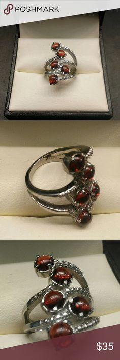 2.25ctw Genuine Garnet 316L Stainless Steel BLACK FRIDAY DOORBUSTER! $35 Beautiful genuine Garnet stainless statement ring. 2.25 carats total weight genuine Garnet. Solid 316L stainless steel ring. Size 6 estate 925 Jewelry Rings