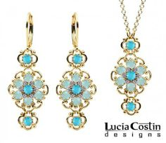14K Yellow Gold Plated over .925 Sterling Silver Jewelry Set: Pendant and Earrings by Lucia Costin with Lovely Flowers, Ornate with Twisted Lines, Turquoise and Mint Blue Swarovski Crystals Lucia Costin. $125.00. Style takes wings in this lovely jewelry set that have a graceful flower shape. Set of jewelry by Lucia Costin. A perfect feminine touch. Handmade in USA unique jewelry set. Designed with turquoise and light - blue Swarovski crystals