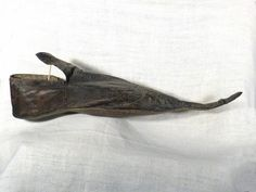 Poulaines are decorated leather shoes with very long, pointed toes, which were very popular among fashionable young men of the late Middle Ages. At their most extreme, poulaines had toes that extended twenty-four inches beyond the wearer's feet and had to be supported by thin chains that connected the toe to the knee.