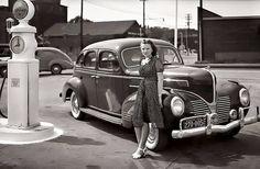 Got gas? Woman vintage car and gas pump