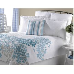 Bright and cheerful, this Veranda quilt set is adorned with a contemporary blue and grey leaf design and filled with soft cotton. The queen-size quilt and included matching shams are great for snuggling up to.