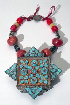 Tibetan amulet case; metal (silver), gilt, stone (turquoise), beads, glass, thread | Acquired 1939