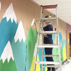 painting mountains at the high school today 👍🏼 // oh and by the way, these are the same halls that i traveled down when i was in high school. i lived in the art department just as my daughter lives in the theatre department, they are right next to each other. it's so surreal and awesome that she and i share a similar passion for the arts and in the same space! although hers is performing arts and mine was visual, it's just so cool for me to be back here supporting her creativity. my heart…