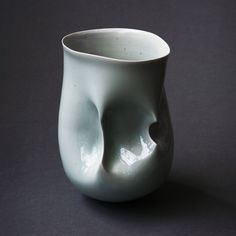 A statement vessel form in porcelain by internationally renowned and collected ceramicist Sara Flynn.Hipped Vessel