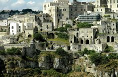 The cave dwellings (the Sassi di Matera) in Madera, Southern Italy. These are the first houses of the Neolithic inhabitants of the region. Check out this site because this photo does it no justice. http://www.sextantio.it/grotte-civita/esplora/