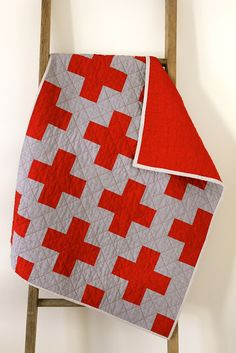 I can't get enough of simple two-colored quilts. Red Cross Baby Quilt by Erica of Craftyblossom.