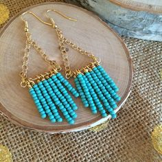 """Gold/Turquoise """"Fringe"""" earrings Fun and trendy beaded earrings in gold and teal. Gold plated earring hooks and chain. Turquoise colored bead strands each hang independently for a playful (but not obnoxious) amount of movement. New, never worn. no PayPal Jewelry Earrings"""