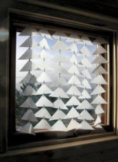 Milk jug window treatment: could be better executed--but has potential.  Also, milk jugs for sun catchers, snowflakes, etc.