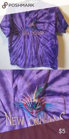 """New Orleans Tie-dye Tee This tee is an awesome purple tie-dye design with an embroidered """"New Orleans"""" and a Mardi Gras mask.  No tag, but it is about a size 8 or medium. It is in excellent condition and from a smoke free home. I'm having a great sale on all children's clothes in my closet, so come check it out and ask  for a custom bundle for an awesome discount! *See my sale posting for details. Shirts & Tops Tees - Short Sleeve"""
