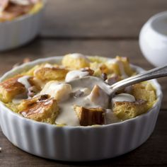 A cozy british favourite, this easy bread pudding sprinkled with walnuts and drizzled with vanilla custard sauce.