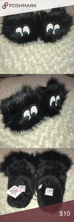 Small 10/11 girls black slippers, very cute Brand is Olivia Miller Girl (OMG) size is small 10/11. Brand new pair of girls slippers. Fuzzy , soft and cute. Front of each slipper has the eyes balls and the fuzzy top making it look like a face. All tags attached. Never worn. Olivia Miller Girl Shoes Slippers