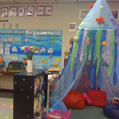 Ocean/Beach themed classroom- grade in photographs! (Teaching Happily Ever After) - Could replicate the reading corner /lounge at home; fun for the summer! Classroom Setup, Classroom Design, Classroom Displays, Future Classroom, School Classroom, Ocean Themed Classroom, Disney Classroom, Autism Classroom, Ocean Themes