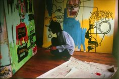 Basquiat painting in his Crosby Street studio. Photo Stephen Torton, 1983.