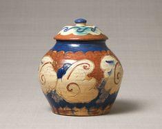 Lidded jar with enameled design of grapes. Raku ware. 1913. Ueno-sakuragi-cho, Tokyo. h.24.3cm.