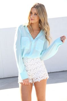 Shirt ideas to wear with my white lace shorts. blue sheer blouse white lace shorts