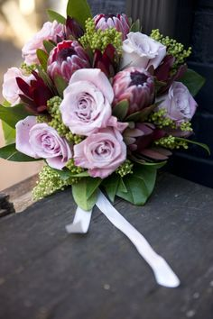 a protea bouquet. this enchanting bundle of beauty will definitely bring out the story-book fairytale wedding you've always dreamed of. Protea Bouquet, All You Need Is Love, Wildflowers, Fairytale, Flower Arrangements, Weddings, Book, Plants, Beauty