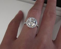2.63 carat, E color, IF clarity round diamond engagement ring with a halo