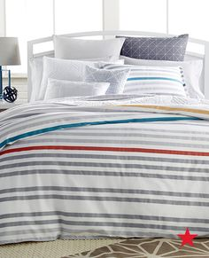 One of our favorite bedspread patterns? Cool stripes! And these sheets from Bar III throw in the perfect pops of color —totally gorge!