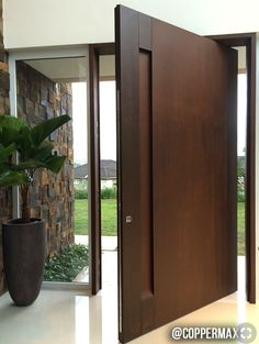 Project developed by architect Lilian Bianccini - Cortén Naturacor® Pivoting Steel Door and Wall Covering: - - Wooden Front Doors, Front Door Entrance, House Entrance, Entry Doors, Modern Entrance Door, Apartment Entrance, Modern Front Door, Front Entry, Wooden Front Door Design