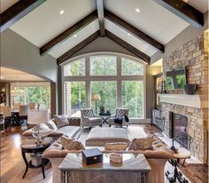 Pitched roof with beam accents complemented by stone fireplace Susan Hoffman Interior Design