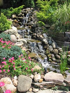 """Thinking about starting a stream by the deck near the """"bridge"""" and meandering with falls to the pond. I'd anchor with a large flat rock near the sit wall transition."""