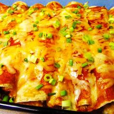 Fabulous Cream Cheese Chicken Enchiladas Recipe.  I think I am going to try this with green enchilada sauce. Yum!