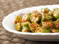Okra Stewed In Tomato Sauce  This IS my very favorite side dish! I add fresh or canned corn to it and most of the time I make rice and just eat the Okra over rice. It's a Southern Girl thang......