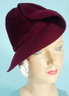 c. 1930's Deep Wine Felt Hat Owned and Worn by ANITA LOOS. Wacky... one side looks like a typical 30s hat, the other side more like a modified beret, and like a newsboy cap from another angle. Just the kind of design you expect to find in a designer hat, but alas... no labels.