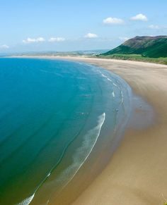 Rhossili Bay, Wales. My aunt Joyce Jones used to own a guest house here years ago. It was painted pink!