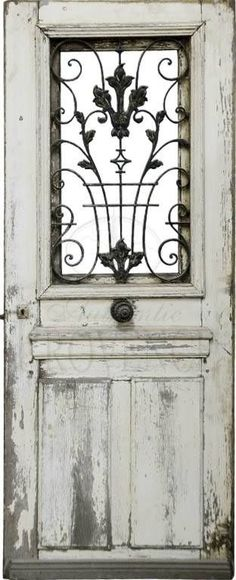 Beautiful old door for a garden gate! Or you could use a newer door, antique it and add an wrought iron or metal detail where the window