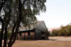 Santiago-based architect Matias Zegers designed the stables for an equestrian centre occupying a three-hectare compound in the foothills of the Andes mountains. Chilean stables by Matias Zegers Architects Concrete Staircase, Gable House, Agricultural Buildings, Public Architecture, Dark Wood Stain, Wood Siding, Roof Light, Skylight, Stables