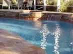 The #spa in this #swimmingpool was beautifully integrated with the brick work and waterfall features. Share your dream swimming pool with Swimming Pools by Ike Jr. inc and we can make it happen! Call us at 954-346-4100 for more information.