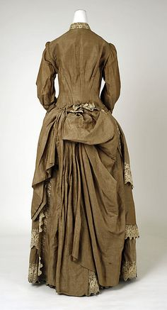 Victorian haute couture fashion dress gown from American designer Gomer Herbert in 1883. Made from cotton, embroidery lace and trim embellishment. A modern representation of women clothing throughout the #historical #19th century. Although the silhouette remained the same incorporated menswear affectation into both ornamentation and construction with decorated high neck, bodice and sleeves. The ruffle skirt drape gather with bustle at the back. #hautecouture #couture #vintage #victorian…