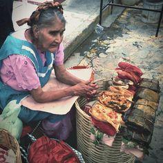 """El Tamal, o """"Tamalli"""" nombre de origen Nahuatl que significa """"envuelto."""" Esta delicacia de origen indígena, preparado usando generalmente harina de maíz cocido al vapor, y  relleno de varios ingredientes. Pueden ser rellenados con frijoles, mole, chiles, pollo, carnes de res o puerco, y tambien de sabores dulces (usando frutas). Envuelto en hoja de maíz o de plátano. El tamal es un delicioso platillo prehispánico de Mexico."""