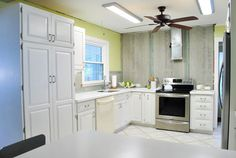 perfectly painted cabinets. the BEST blog i've seen for this project yet. tons of pictures and details, even a video!