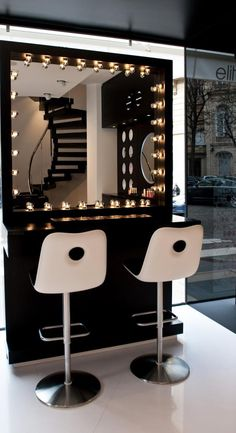 Beautiful lit up make up bar -- would be incredible in a salon
