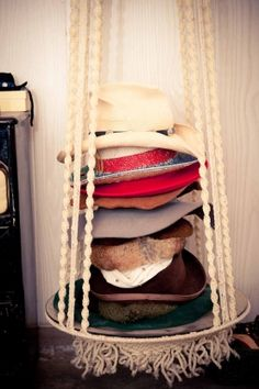 Gillians home / the coveteur / hat display /