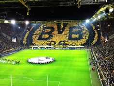 #MFC4012 This is Borussia Dortmund's Yellow Wall Stand. This is where fans hold a piece of paper up and it creates an image. I have a soft spot for Borussia Dortmund even though i am a Liverpool fan
