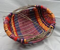 Appalachian melon, egg, and potato baskets made with vine, dyed rattan, yarns, and seagrass.