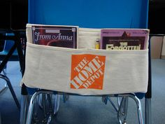 Free nail apron from Home Depot turned into chair-apron to hold books. Brilliant. Clever. Amazing.