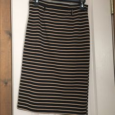 "Striped skirt! Form fitting skirt! Hits right below the knee (I'm 5'4"") black and light brown stripe with belt straps and a zipper on the side! Skirts Midi"
