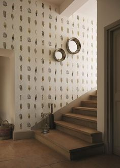 Lovely neutral wallpaper pattern by Harlequin featuring rows of delicate feathers.