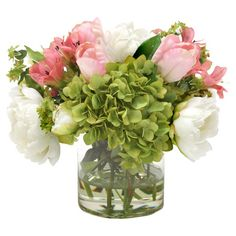 Bring organic elegance to your decor with this lovely faux hydrangea and peony arrangement, showcasing lush blooms and leaves nestled a glass vase. ...