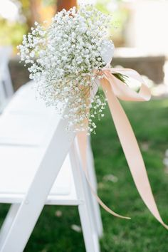 baby breath wedding chair arch decor / http://www.deerpearlflowers.com/rustic-budget-friendly-gypsophila-babys-breath-wedding-ideas/4/